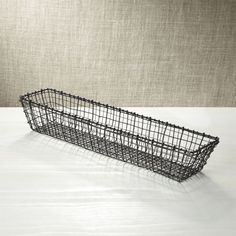 Metalwork basket is crafted of different gauges of iron wire in a casual, artisanal weave. Zinc plating and an antique finish add to the basket's warmth and textural appeal. iron with zinc-plated and antique brass finish Food-safe Hand wash Made in India Crate And Barrel, Square Baskets, Mid Century Modern Kitchen, Iron Wire, Wire Baskets, Bread Baskets, Storage Baskets, Custom Furniture, Metal Working
