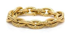 An 18 Karat Yellow Gold Link Bracelet, Tiffany & Co., 35.80 dwts. - Price Estimate: $1500 - $2500
