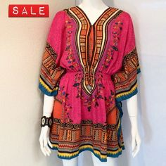 """Nathalie B Dashiki Colorful West African Top Nathalie B Dashiki V Neck Colorful West African Top with Butterfly Sleeves and Stretched Waist Band. Size Small. Measurements: Armpit to Armpit 24"""", Length 34"""". 100% Polyester. Hand Wash. Dry on low heat. Nathalie B  Tops Blouses"""