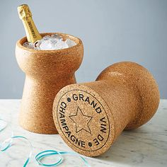 @evelynfowler You need this!!! Champagne Cork Cooler