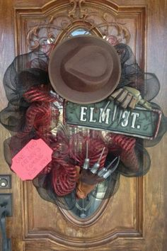 NIGHTMARE ON ELM STREET /Freddy wreath. A friend lived on an ELM ST. This is a good door decoration to just hang out for Scary Movie Night ...fun to show the movie at a friend's place who really lives on an ELM ST. :)                                                                                                                                                      More