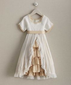 exclusively ours - girls smocked fairy-tale chiffon dress - This romantic dress looks like it came straight off the pages of a fairy-tale storybook. Vintage-inspired, it's detailed with a sweetly smocked bodice, satin ruffles and sash, and dreamy chiffon overlay with ruffle trim. The dress practically floats.