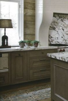 love the vibe of this pool house kitchen........good amount of rustic and freahness love cabinetry color and style...like the range hood, and clean stone backsplash...love it all....but really dont want white marble......??
