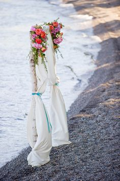 simple arbor for lakeside wedding http://www.weddingchicks.com/2014/03/03/lake-tahoe-estate-wedding-with-coral-and-teal-colors/