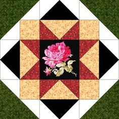 Our quilt kit is already precision pre-cut for accuracy. Beautiful fussy cut rose corsage in shades of pink and yellow with green leaves on a jet black background. A beige vine, a burgundy red vine, a
