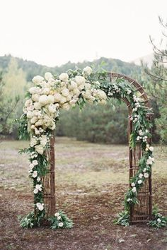 brides of adelaide magazine - romantic wedding - pale pink and green - archway - garland