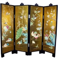 """Golden Peacock Four Panel Screen. Reverse side is gold with Chinese characters, each a different way to write """"Long Life""""."""