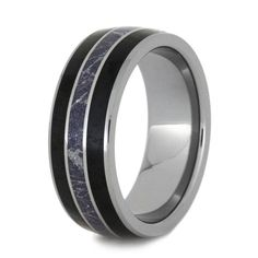 Glistening with a rich set of materials, this tungsten wedding band is a ring to be treasured. Captivating mokume is encircled between two mysterious bla...