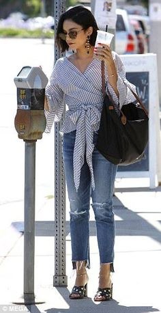 Chic: Vanessa completed her casual daytime look with a black Longchamp bag and stylish sha...