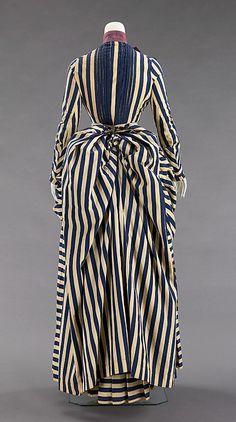 Dress.  Date: 1885–88. Culture: American. Medium: cotton, silk. Dimensions: Length at CB (a): 18 1/2 in. (47 cm). Length at CB (b): 44 1/2 in. (113 cm).