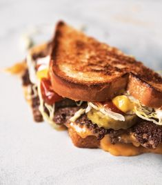 The key to this cheeseburger is the technique. The patty is extra thin, which allows for more surface area to brown and crisp. Cheese Stuffed Peppers, Potato Bread, Beef Patty, Hamburger Patties, Wrap Sandwiches, Burger Recipes, Food 52, Recipe Of The Day, Mac And Cheese
