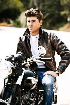 A real man rides a motorcycle.