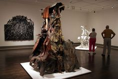 """FILE - In an Oct. 11, 2005 file photo, a large sculpture by artist Thornton Dial, titled """"Shacktown,"""" stands in the center of a gallery in the Museum of Fine Arts Houston at a show featuring works by the Alabama native, in Houston. Dial, who was self taught and who transformed discarded junk into sculpture and painted in bright colors and bold lines, died Monday, Jan. 25, 2016, at his home in Alabama. He was 87. Photo: Pat Sullivan, AP / AP"""
