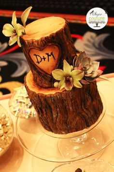 Sugar Couture tree stump wedding cake on cake central.