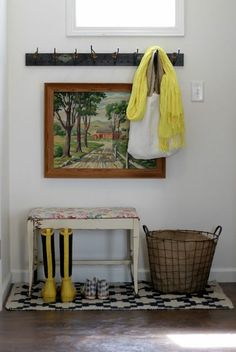Nice small rug under the entry way bench and I like the basket. Maybe layer a rug over the FLOR tiles?