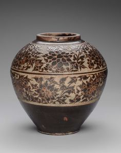 Chinese, Song dynasty, 12th century | Jar with carved glaze designs of flower scrolls