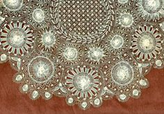 """Handmade Lace:  Nanduti Lace.  """"A lace known as 'Tennerife' developed in the Canary Islands and Spain and then spread to Latin America where it was called 'Nanduti.'  Radiating circular scaffolds of threads were first stretched on a base, and fancy fillings were needle-woven on these threads.  This piece dates from the early 20th century but such lace is still produced.  Unfortunately, few current examples have this delicacy."""""""