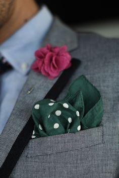 Blazer with navy trim, blue oxford shirt, floral tie, green tie clip, pink lapel flower, green polka dot pocket square,