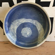 A small, modern serving tray I threw on a pottery wheel. I applied blue and white slip in a modern, abstract pattern, then fired it with a clear, crackled glaze.