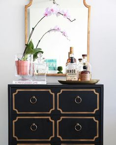 Elements of the perfect vignette: Storage piece with character, a piece of art or mirror at least 3/4 the width, something tall to connect the storage piece to the art or mirror and sculptural pieces to the side to balance it all out.