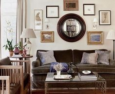 living rooms - ivory brown purple wood beveled convex mirror velvet brown sofa glass top coffee table wood upholstered chairs lamp iron floor lamp oatmeal gray linen drapes curtains eclectic photo gallery silk purple pillows
