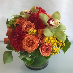 A coffee table floral of dahlias, spray roses, tansy, miniature green hydrangea, tree ivy and cymbidium orchids. Beautiful Bouquet Of Flowers, All Flowers, Beautiful Roses, Fresh Flowers, Green Hydrangea, Hydrangea Tree, Vase Arrangements, Flower Arrangement, Yellow Orchid