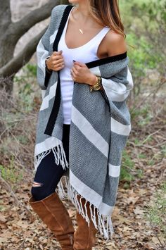 Stay cozy this season in our Montreal Poncho! Featuring a striped color block, open front and fringed hemline. 100% Acrylic Hand wash