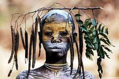 The Surma tribe use flora and fauna as adornments. ©Hans Silvester