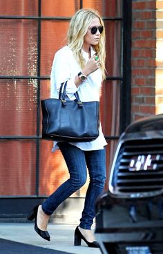 15 Ways To Do New York City Like An Olsen Twin // Mary-Kate Olsen with wavy hair, aviator sunglasses, white button-down shirt, The Row tote, jeans & heels #style #fashion #mka #olsentwins