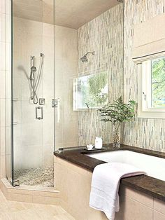 Nature inspired this gorgeous master bath: http://www.bhg.com/bathroom/remodeling/makeover/before-and-after-bathrooms/?socsrc=bhgpin081114bathingaunatural&page=11