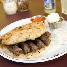 Lepinja and čevapčiči (Slovenian spelling) actually a Serbian national dish, but served all over the Balkans. The red stuff is Ajvar, a red pepper paste. Best nom ever.