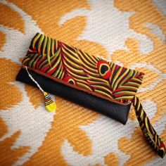 African Wax Print Clutch Bag - Red+Yellow Peacock Wax Print + Black Faux Leather Trim - Bridesmaid's Gift - (RYPBL1) by ChangNoii on Etsy
