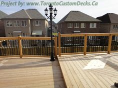 Cool idea of pitting up a lamp post like this for lighting in the deck. #Deck design #custom deck #patio #Toronto