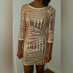 Gold Sequins Dress Fun, show stopper, all eyes on me piece! Gold mini sequins dress, worn only once. Tiny lip gloss stain (see 2nd pic) unnoticeable, however can be cleaned for perfection! Price reflects very discounted original purchase price, a total bargain!!!  15% off 2 items smoke free closet make offer using the offer button, not in comment section shipping 1-3 business days Dresses