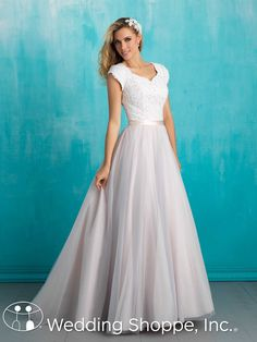 A stunning modest cap sleeve wedding dress.