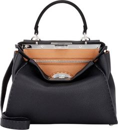 Fendi Selleria Peekaboo Satchel at Barneys New York. Over 4 grand. Ouch, but not for a rich bitch.