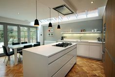 oxford extension with leicht kitchen design and Nigel Slater inspired flowing doors and herringbone parquet