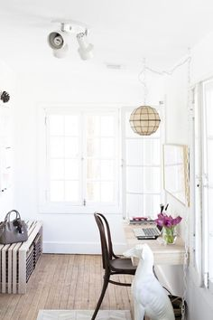 The lovely, light-filled workspace of blogger and nutritionist Carlene Thomas.