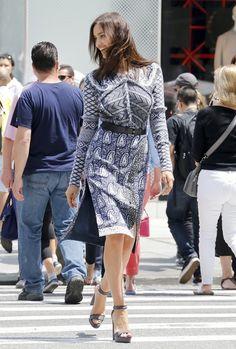 Irina Shayk Platform Sandals - Gray ankle-strap platform sandals completed Irina Shayk's outfit.