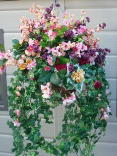 Hanging basket large with artificial fuchsias, seven heaven & daisies