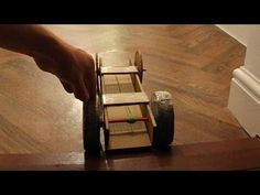 Can you make a car with cardboard, binder clips and paper clips (optional) can only be used for the axles, rubber bands, and clear tape only. The axles can b. Rubber Band Car, Cardboard Car, Cars Youtube, Binder Clips