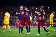Neymar Santos Jr of FC Barcelona is congratulated by his teammates Luis Suarez and Jordi Alba after scoring his team's fifth goal during the La Liga...