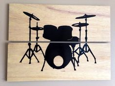 "The 2 piece light wood art canvas takes a minimalist approach to make the ""drum love"" shine. The silhouette is painted in black which contrast nicely against the light wood grain background."