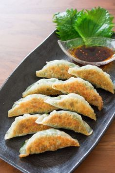 Crisp on the bottom, tender on top, these pork and garlic chive gyoza (餃子) are wrapped with green shiso for a tasty twist on classic Japanese potstickers.