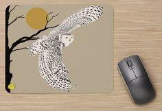 La série: tapis de souris; mouse pad; art sur tapis de souris; harfang, léopard, loup