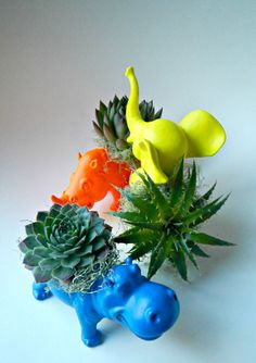 I Cant Believe Its From Etsy: Planters: Three mini terracota planters ($18) look cheery and fun when strung together on a leather cord — perfect for air plants, ferns, or a little hanging herb garden.: Neon animal planters ($50 for three) practically steal the show right out from under the plants they are carrying.