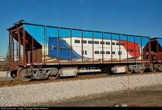 When Utah Transit Authority was building its new tracks between Salt Lake City and Ogden adjacent to Int.15 most of the way, it painted its ballast cars with its new FrontRunner red, white and blue scheme to show motorists what was coming.