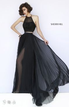 A two-piece beauty we are obsessing over! Right on point Sherri Hill never disappoints! Sherri Hill 32109 has a halter upper bodice embellished with bead work and an open back. Fitted at your natural waist, a small gap is in place before the sleek pleated skirt floats down your silhouette. Hidden underneath is a sexy slit that is perfect for showing off your awesome choice of shoe!