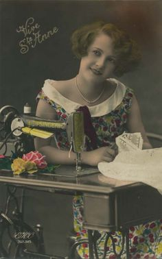 Vintage sewing postcard - lady posing with Singer sewing machine.