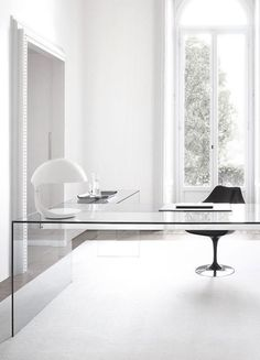 glass desk, black chair, white desk lamp, office ideas, white walls and rug Gray Home Offices, Industrial Home Offices, Industrial Office Design, Home Office Design, Home Office Decor, Office Ideas, White Desk Office, White Desks, House Essentials